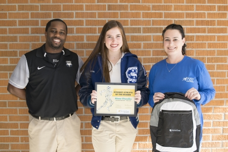 Alana Chandler with, from left, Springfield High School Lady Bulldogs Head Basketball Coach Byron Garner and North Oaks Sports Medicine Athletic Trainer Mandy Serpas